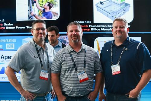 three male attendees at GlassBuild 2019 in Atlanta